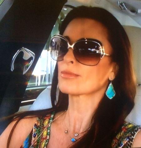 Kyle Richards wearing the Kendra Scott Alexandra earring on secrets revealed