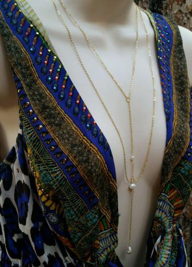 Stassi Schroeder's Gold Y Necklace During Interviews