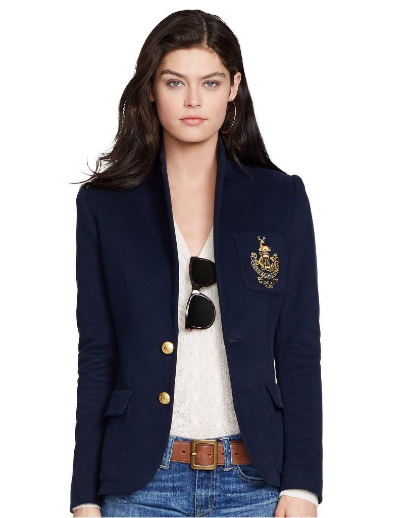 Navy blue blazer with gold crest