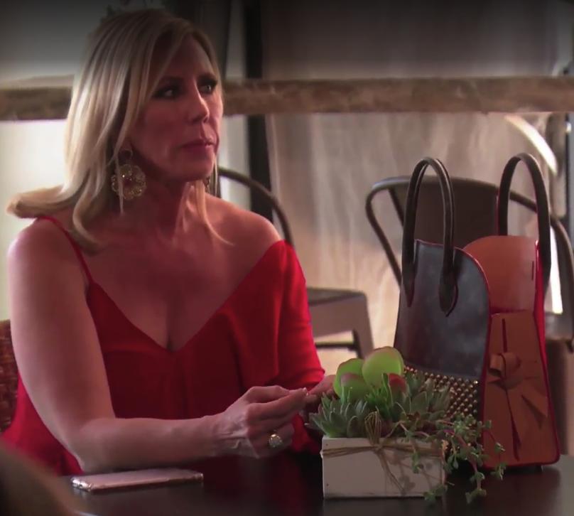 Vicki Gunvalson's Red Asymmetrical One Sleeve Top
