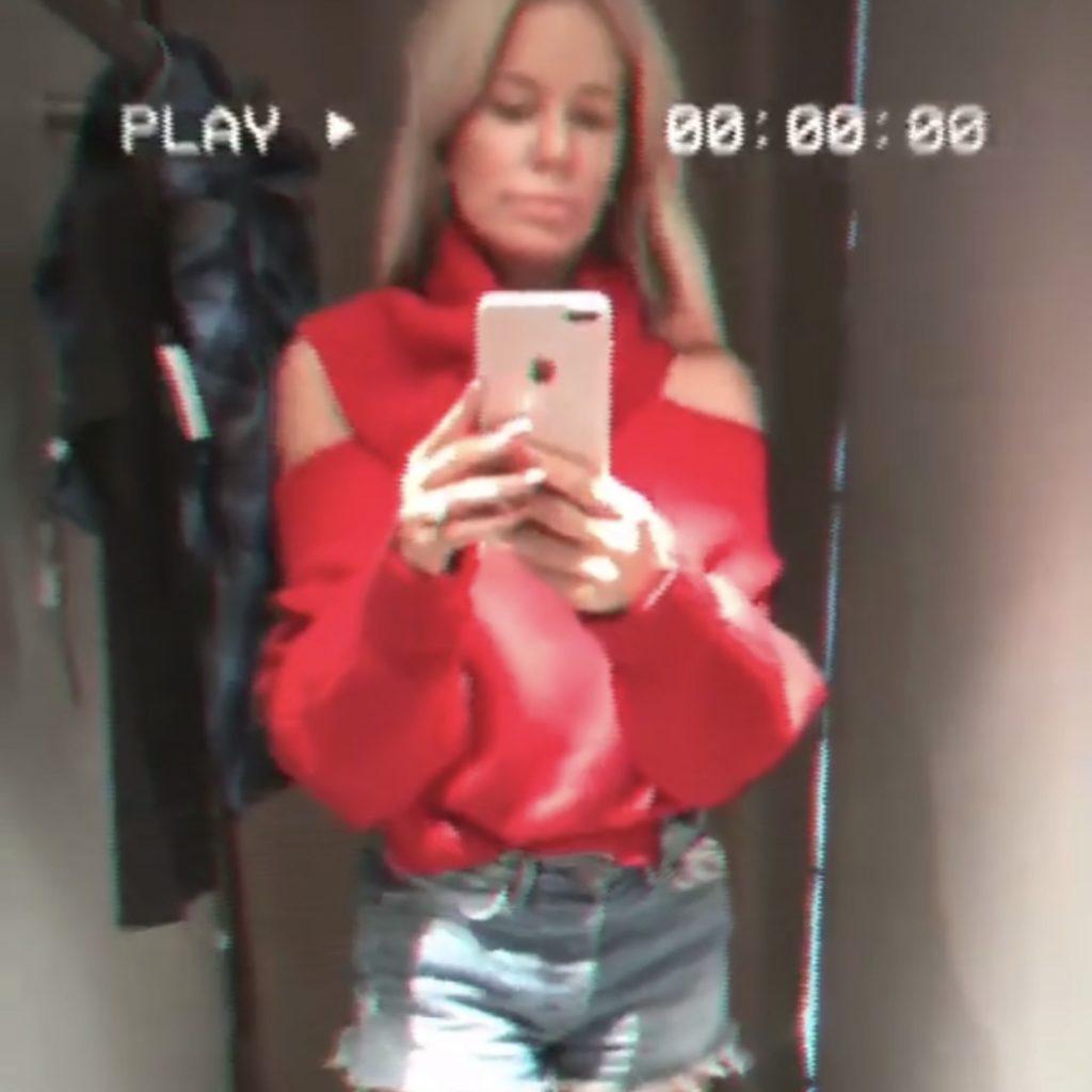 Caroline Stanbury's Red Cold Shoulder Sweater on Instagram