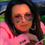 Kyle Richards' Pink and Purple Aviator Sunglasses