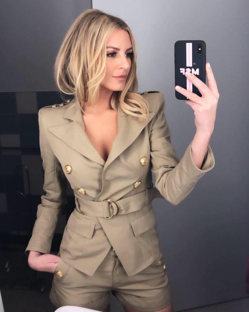 Morgan Stewart's Gold Button Khaki Suit