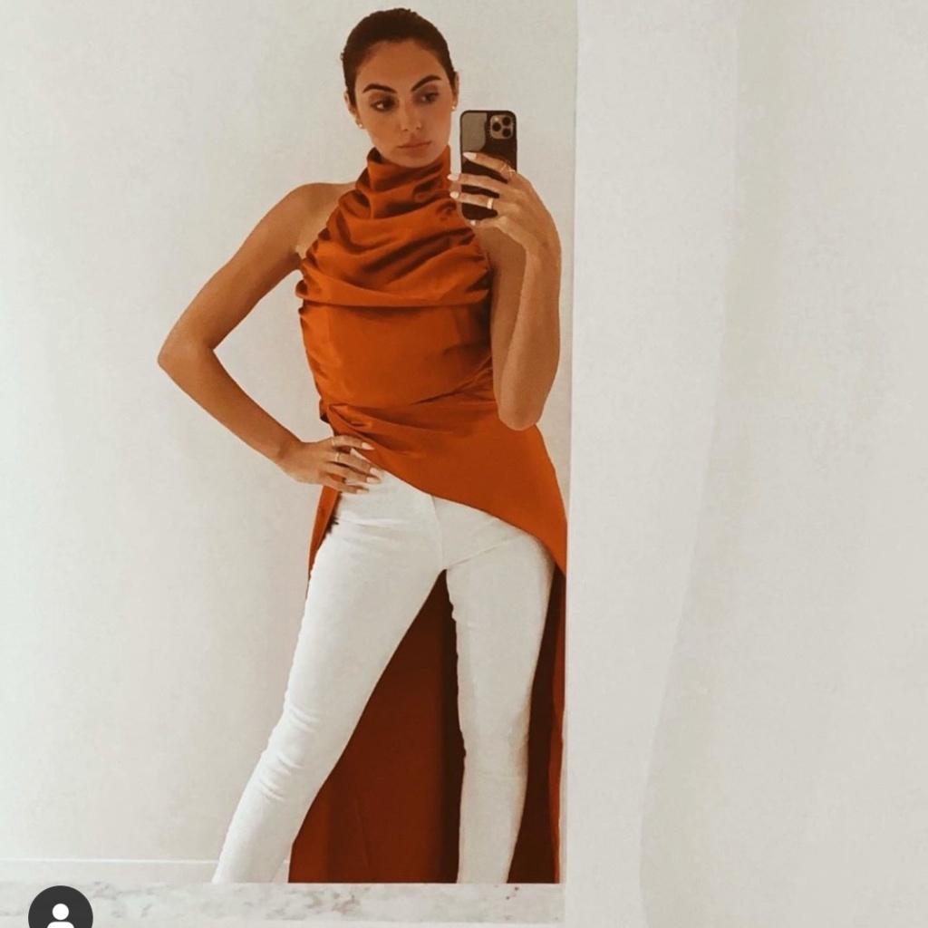 Paige DeSorbo's Orange Satin Top