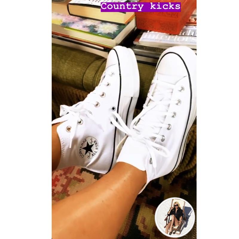 Caroline Stanbury's White High Top Sneakers
