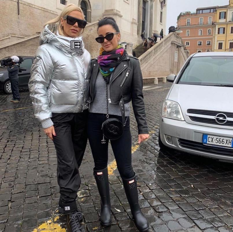 Dorit Kemsley's Silver Puffer Coat in Rome, Italy