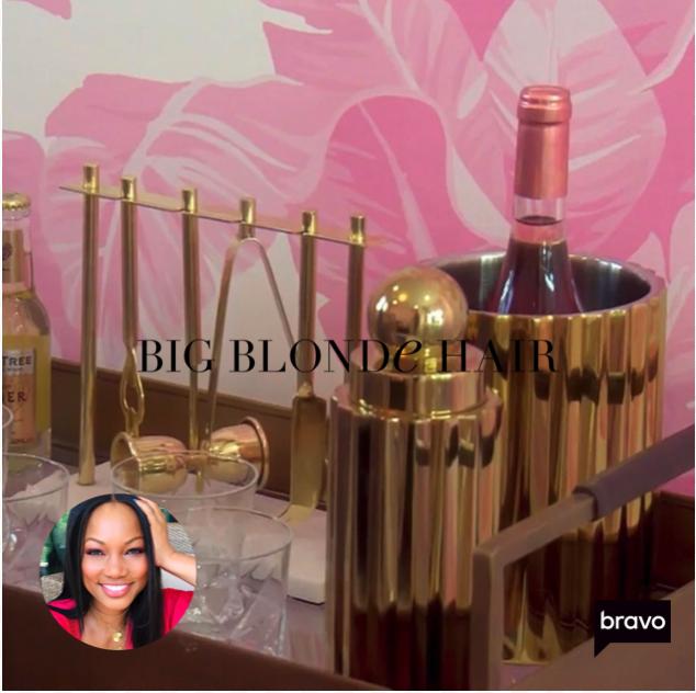 Garcelle Beauvais' Gold Bar Tools on Her Bar Cart
