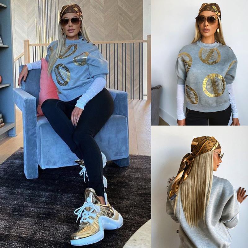 Dorit Kemsley's Grey and Gold Stamped Sweatshirt