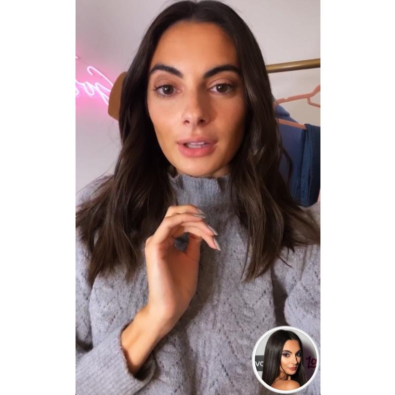 Paige DeSorbo's Grey Ruffle Neck Sweater