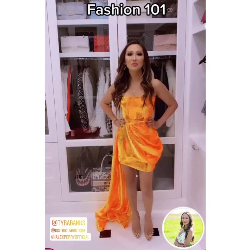 Tiffany Moon's Orange Sequin Draped Dress