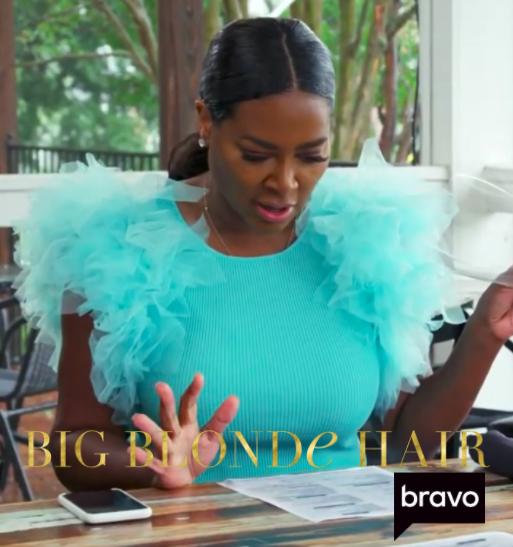 Kenya Moore's Turquoise Tulle Sleeve Top