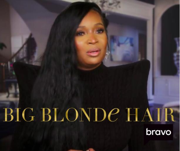 Marlo Hamption's Black Pointed Shoulder Confessional Look