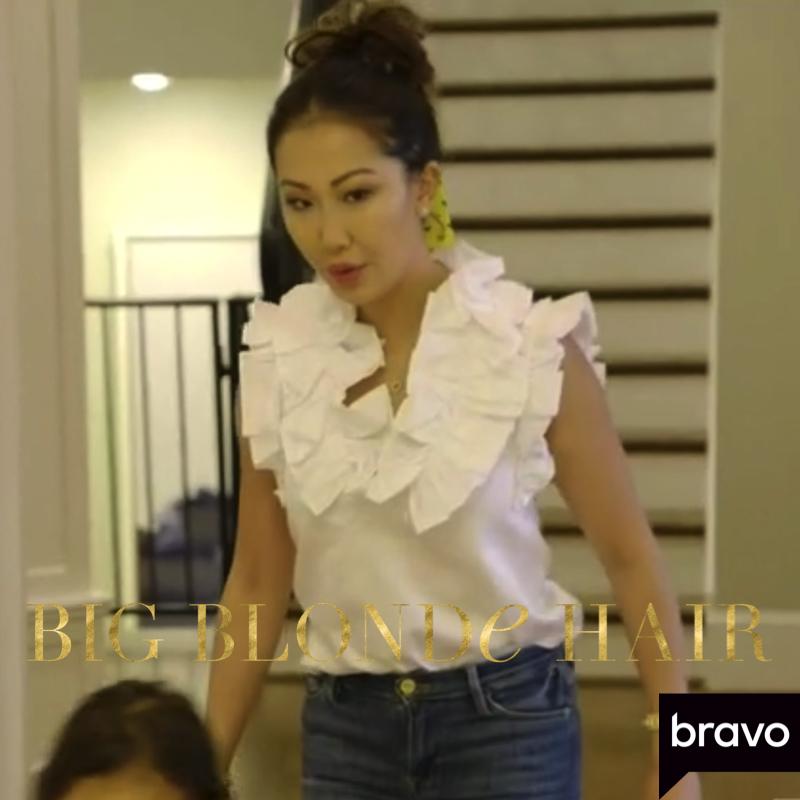Tiffany Moon's White Ruffle Neck Top