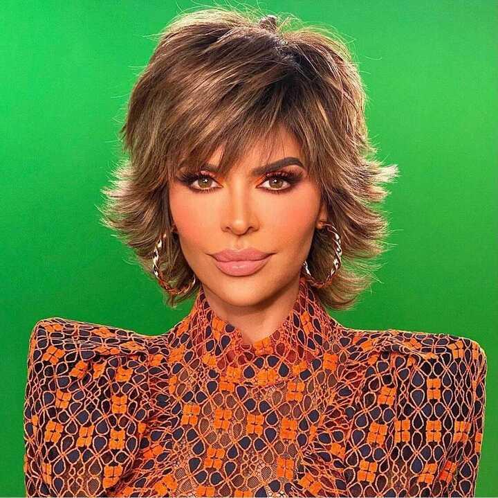 Lisa Rinna's Orange Lace Confessional Look