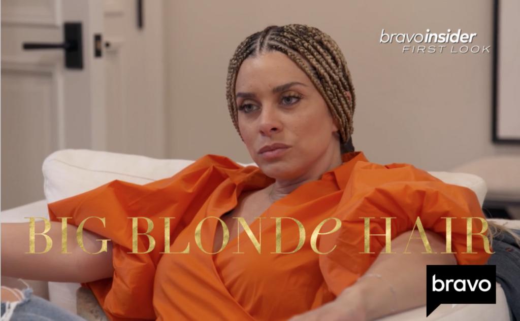 Robyn Dixon's Orange Puff Sleeve Wrap Top